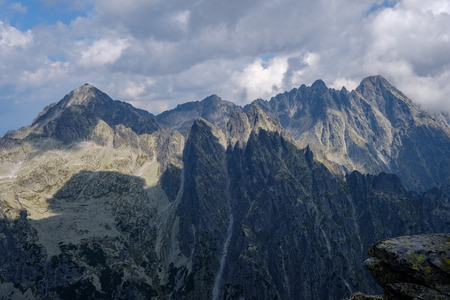 rocky hiking trails for tourists in western carpathian Tatra mountains in slovakia. clear summer day for hiking and adventure