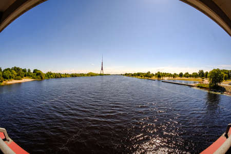 Riga city, capital of Latvia panoramic view with river Daugava and cable bridge with calm water in summer 版權商用圖片