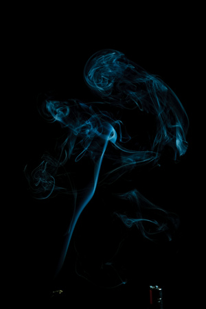 white smoke on black background. smoke waves from gas lighter Stock Photo
