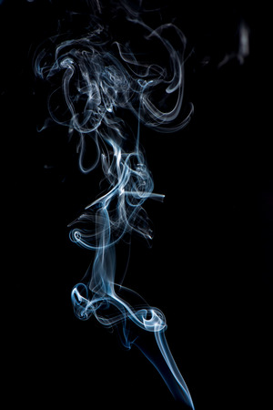 white smoke on black background. artistic abstract