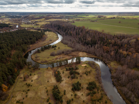 drone image. aerial view of rural area with snake river in forest. autumn in Latvia Stock Photo