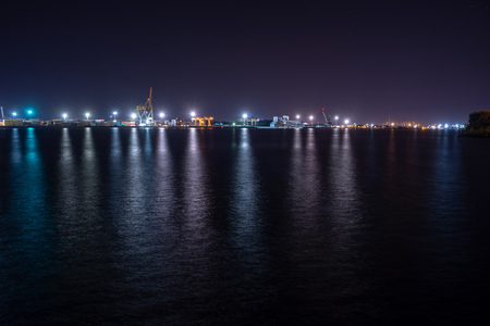 night street lights in Riga, Latvia. lines from cars and bridges 写真素材