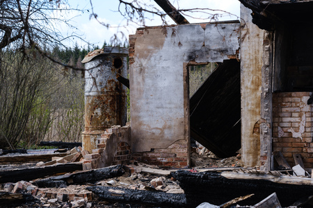 abandoned burned down house details, empty rooms and burnt wood logs