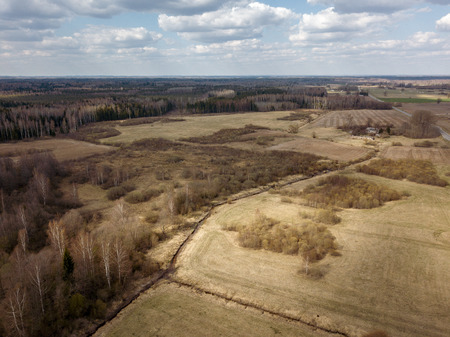 aerial view of countryside fields and forests with small lakes in overcast spring day Reklamní fotografie
