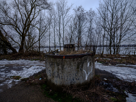 metal and concrete fence in city of RIga, Latvia.. winter day Banco de Imagens - 121943571