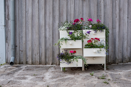 flower stand made from old drawer in garden, country