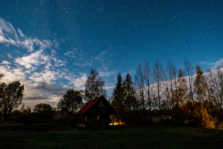 night sky with stars and clouds in long exposure shot. night startrail photograph