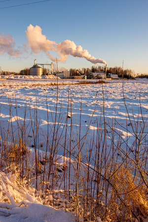 industrial smoke from large chimneys in winter. white smoke steam