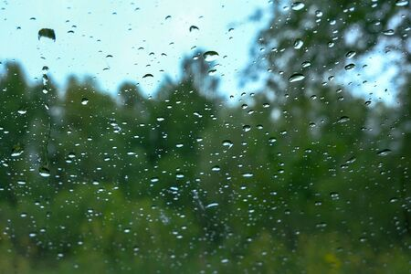 rain drops on window glass. view from inside out Фото со стока