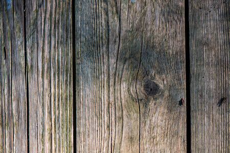 old wooden plank textured surface with splinters and cracks. aged background Imagens