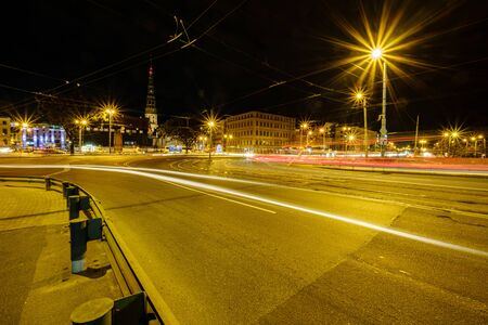 panoramic view of Riga city in Latvia. Capital of Latvia at night with street lights