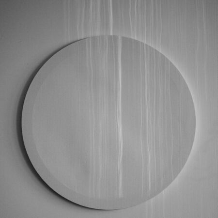 empty decorative round white canvas for painting on the white wall  with sun rays and shadows Stock fotó