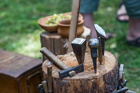wood working tools on the wooden stump in park