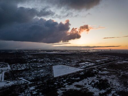 dramatic winter sunrise over city of Riga in Latvia. aerial drone image
