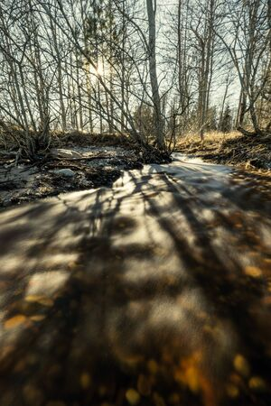 river flowing to the sea in direct sunlight. long exposure shot with blur water 版權商用圖片