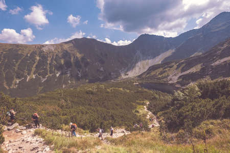 hiking trail on top of the mountain. Tatra, Slovakia. Western carpathian mountains in early autumn colors with clean air. Tourist track - vintage retro look 版權商用圖片 - 150722974
