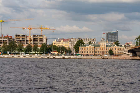 Riga city, capital of Latvia panoramic view with river Daugava and cable bridge with calm water in summer 新聞圖片