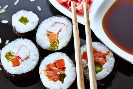 Japanese sushi on a black plate Stock Photo