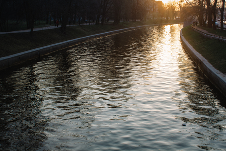 wonderful landscape texture of golden sunset on the surface of the river channel Imagens