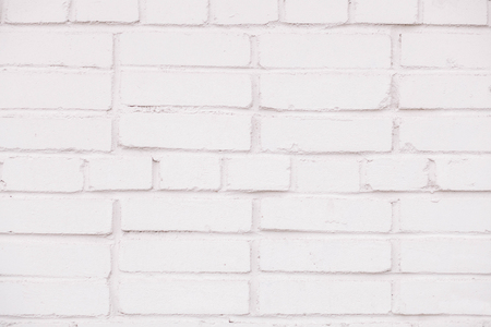 An old laying from the painted brick. Texture background concept white brick wall background in rural room. Stock Photo