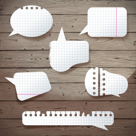 babble: Paper speech bubbles over wooden background