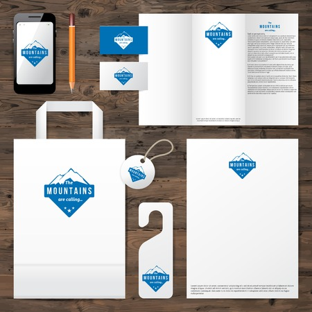 Identity template with mountain logo design over wooden background