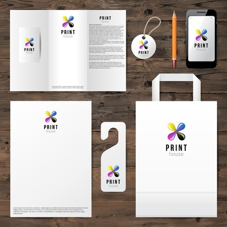printing house: Identity template with cmyk logo design over wooden background