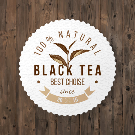 green tea leaf: round emblem with hand drawn tea leaf and type design on wooden background