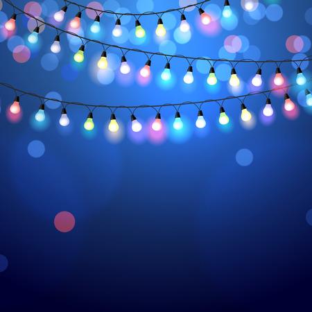 gloeiende Kerstverlichting op een blauwe achtergrond