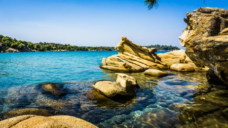 sithonia: Beautiful Small Beach With Rocks Around It And Turquoise Water in Sithonia, Halkidiki, Greece