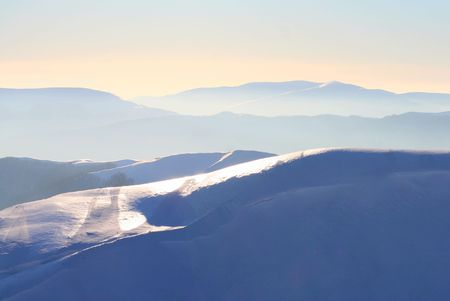 eminence: Winter mountains under the snow in soft haze.