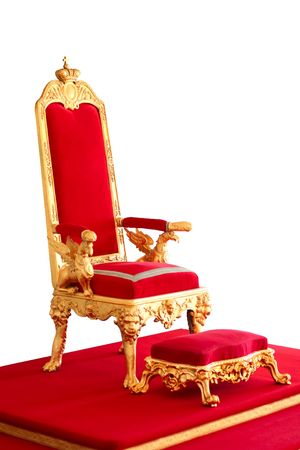 Golden imperor's throne made from gold and red velvet Фото со стока