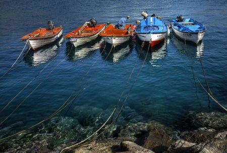 trabajo: barcos pesqueros anclados en aguas del puerto de la Aldea, Gran Canaria Stock Photo