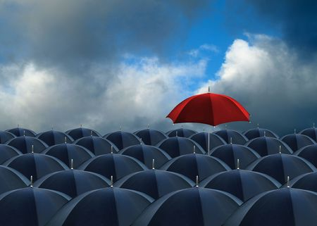 stand out: red umbrella standing out from the rest