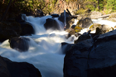 photo of whitewater rapids flowing through boulders and rocks in southern Oregon