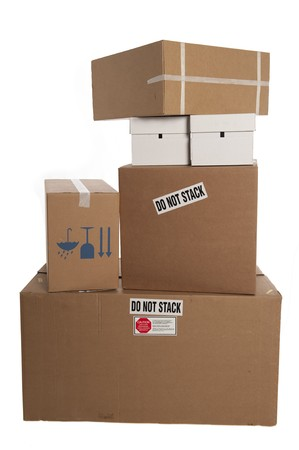 Stacked boxes with stickers saying