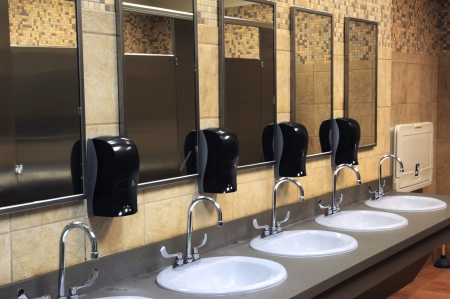 latrine: lavatory sinks in a public restroom