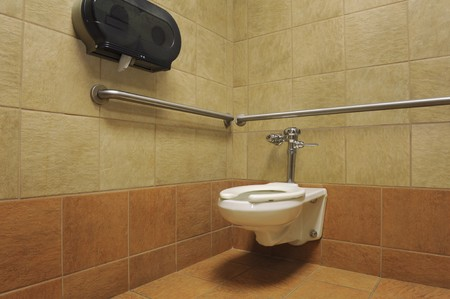 toilet in an attractive handicapped accessible stall of a public restroom
