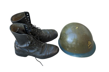combat boots: Old American military boots and helmet on white Stock Photo