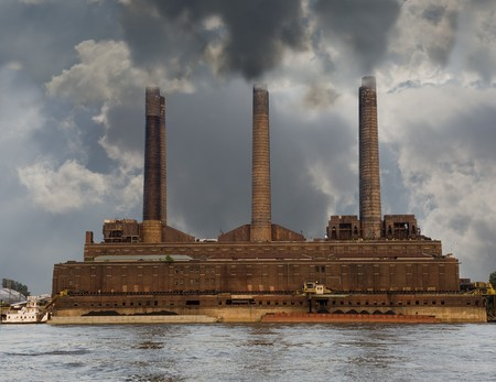 Old brick powerplant pumps out smog and smoke along the river photo