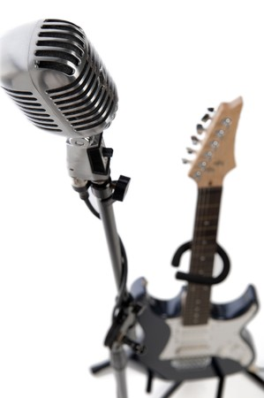 Vintage microphone on stand with a colorful scarf Stock Photo