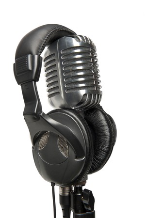 Vintage studio microphone with a pair of modern headphones