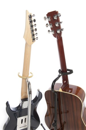 strat: Rear view of an electric guitar and acoustic guitar