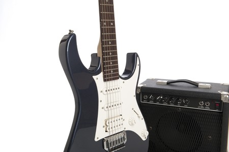 Electric strat guitar and medium practice amplifier photo