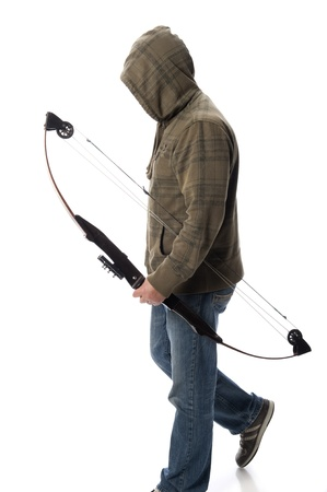 hoodlum: Hoodlum walks with a compound bow and arrow in hand isolated on white