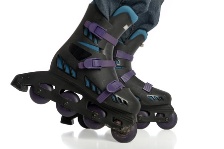 Close-up of dirty rollerblades in action isolated on white
