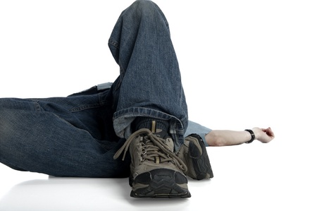 man lying on his back, focus on feet near the camera