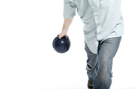 bowler throwing a blue marbled bowling ball isolated on white Stock Photo