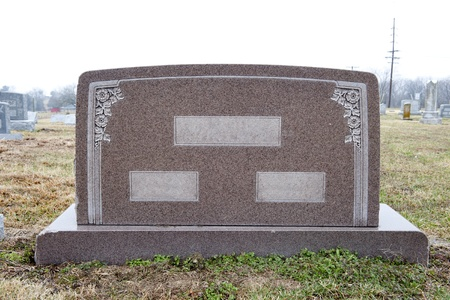 Marble tombstone with places to write two individuals names and their common last name