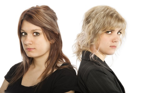 Two young women back to back looking unhappy Stock Photo